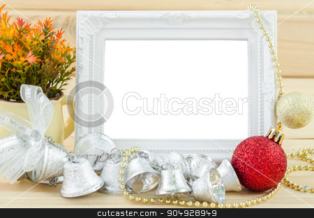Vintage white blankk photo frame with chirstmas decorations. stock photo, Vintage white blankk photo frame with chirstmas decorations on wood background. Save clipping path. by Miss. PENCHAN  PUMILA