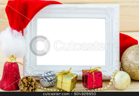 Vintage photo frame and christmas decorations. stock photo, Vintage photo frame and christmas decorations on wood background. Save clipping path. by Miss. PENCHAN  PUMILA
