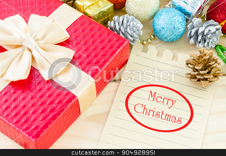 Merry Christmas word writing on brown paper. stock photo, Merry Christmas word writing on brown paper with christmas decorations on wooden background. by Miss. PENCHAN  PUMILA