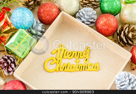 The words Merry Christmas with christmas decorations. stock photo, The words Merry Christmas with christmas decorations on wood background. by Miss. PENCHAN  PUMILA