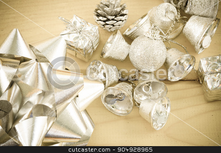 Silver bell and silver ribbon in vintage background. stock photo, Christmas decoration. Silver bell and silver ribbon in vintage background. by Miss. PENCHAN  PUMILA