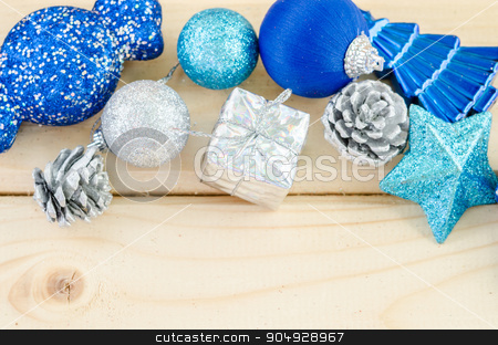 Blue christmas decorations. stock photo, Blue christmas decorations on wooden background. by Miss. PENCHAN  PUMILA