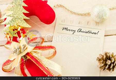 Merry Christmas word writing on brown paper. stock photo, Merry Christmas word writing on brown paper with christmas decoration on wooden background. by Miss. PENCHAN  PUMILA