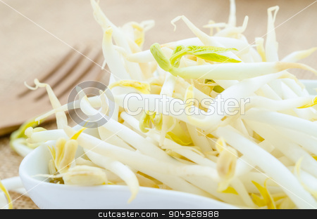 Mung bean sprouts in white cup. stock photo, Mung bean sprouts in white cup on sack background. by Miss. PENCHAN  PUMILA