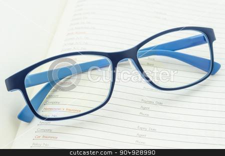 Eyeglasses on open diary planner. stock photo, Eyeglasses on open diary planner. by Miss. PENCHAN  PUMILA