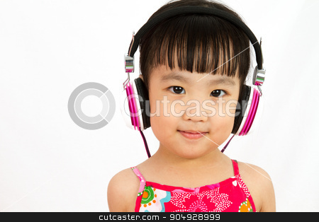 Chinese little girl on headphones stock photo, Chinese little girl on headphones smile with plain white isolated background. by Tan Kian Khoon