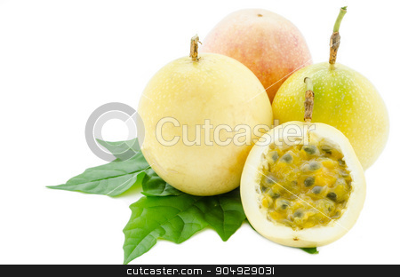 Yellow Passion fruit and green leaf. stock photo, Yellow Passion fruit and green leaf on white background. by Miss. PENCHAN  PUMILA
