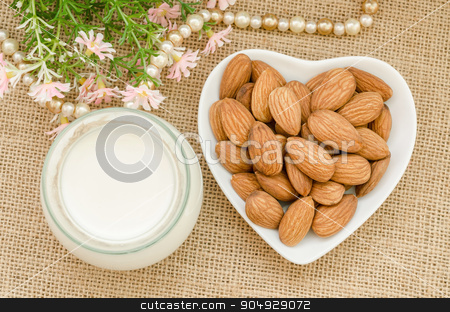 Almond milk with almond on a white bowl cup. stock photo, Almond milk with almond on a white bowl cup with flower on sack background. by Miss. PENCHAN  PUMILA