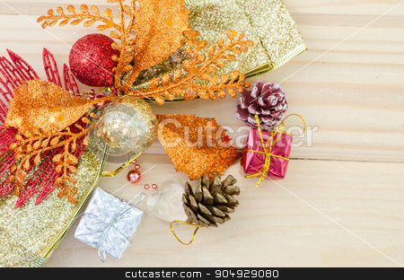 Christmas decoration with presents on wood. stock photo, Christmas decoration with presents on wood background. by Miss. PENCHAN  PUMILA