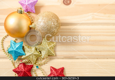 Christmas decorations on wooden. stock photo, Christmas decorations on wooden background. by Miss. PENCHAN  PUMILA