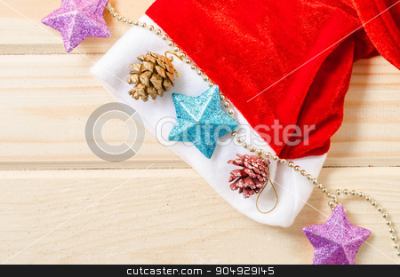 Santa Hat with Christmas decorations. stock photo, Santa Hat with Christmas decorations on wooden table by Miss. PENCHAN  PUMILA