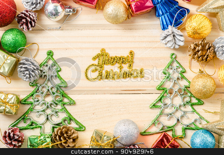the words merry christmas with christmas decorations. stock photo, the words merry christmas with christmas decorations on wooden background. by Miss. PENCHAN  PUMILA