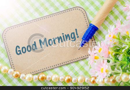 Good morning wording on brown paper. stock photo, Good morning wording on brown paper with pen on cloth. by Miss. PENCHAN  PUMILA