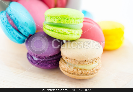Colorful macaroons in white cup. stock photo, Colorful macaroons in white cup on wooden background. by Miss. PENCHAN  PUMILA
