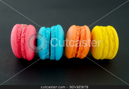Colorful macaroon on black. stock photo, Colorful macaroon on black background. by Miss. PENCHAN  PUMILA