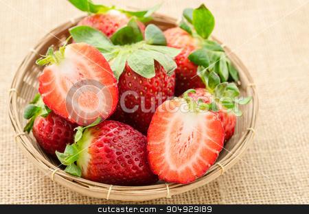 Fresh strawberries in weave basket. stock photo, Fresh strawberries in weave basket on sack background. by Miss. PENCHAN  PUMILA