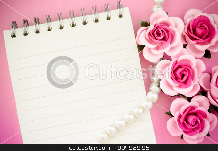 roses and open notebook. stock photo, roses and open notebook on pink background. by Miss. PENCHAN  PUMILA