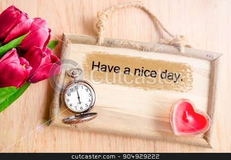 Have a nice day. stock photo, Have a nice day. Clock and red tulip with red candle heart shape on wooden background. by Miss. PENCHAN  PUMILA