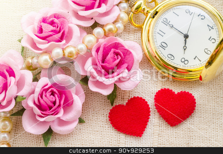 Red heart and pink rose with gold pocket watch. stock photo, Red heart and pink rose with gold pocket watch on fabric background. Love of time concept. by Miss. PENCHAN  PUMILA