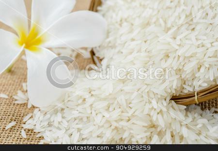 Spoon with rice jasmine. stock photo, Wooden Spoon with rice jasmine and white flower by Miss. PENCHAN  PUMILA