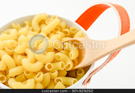 Raw dry elbow macaroni with wooden spoon.  stock photo, Raw dry elbow macaroni with wooden spoon. Italian Pasta raw food in white bowl on white background. by Miss. PENCHAN  PUMILA