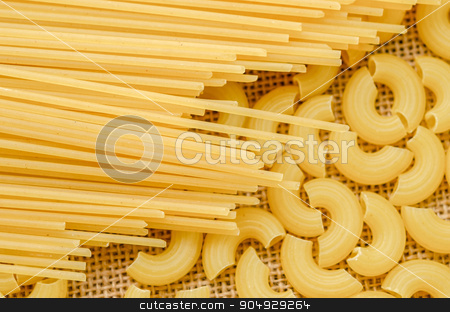 Raw spaghetti and Elbow macaroni. stock photo, Raw spaghetti and Elbow macaroni noodles on sack background. by Miss. PENCHAN  PUMILA