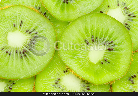 Many slices of kiwi fruit. stock photo, Many slices of kiwi fruit texture as background. by Miss. PENCHAN  PUMILA
