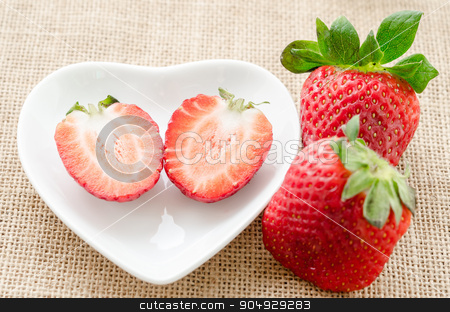 Ripe sweet strawberries. stock photo, Ripe sweet strawberries in white bowl on sack background. by Miss. PENCHAN  PUMILA
