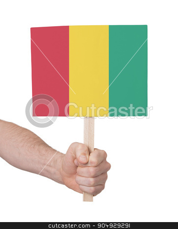 Hand holding small card - Flag of Guinea stock photo, Hand holding small card, isolated on white - Flag of Guinea by michaklootwijk