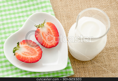 Strawberries and milk drink. stock photo, Strawberries and milk drink in glass on tablecloth and sack background. by Miss. PENCHAN  PUMILA