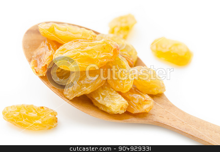 Yellow or gold raisins. stock photo, Yellow or gold raisins in wooden spoon on white background. by Miss. PENCHAN  PUMILA