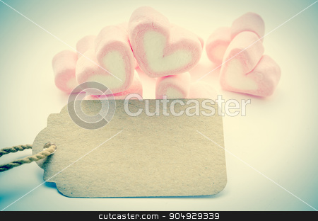 Pink Marshmallow heart shape with blank paper tag. stock photo, Pink Marshmallow heart shape with blank paper tag for your text in vintage style. Love concept. by Miss. PENCHAN  PUMILA