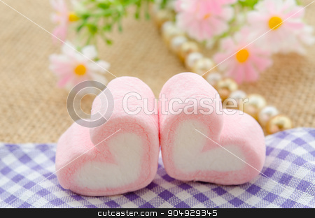 sweet heart shape of pink marshmallows. stock photo, sweet heart shape of pink marshmallows with flower on tablecloth background,decoration for love and valentine day concept. by Miss. PENCHAN  PUMILA
