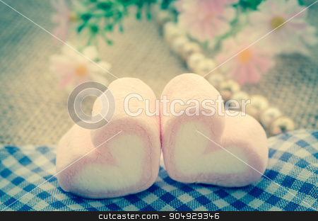 sweet heart shape of pink marshmallows. stock photo, sweet heart shape of pink marshmallows with flower on tablecloth background,decoration for love and valentine day concept vintage style. by Miss. PENCHAN  PUMILA