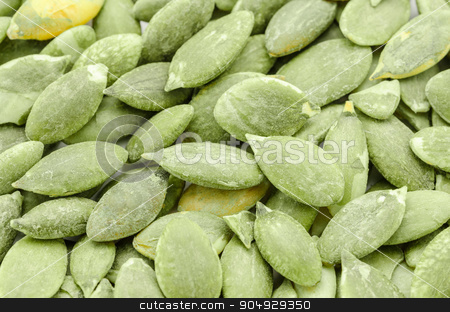 pumpkin seeds. stock photo, Macro background texture of green pumpkin seeds. by Miss. PENCHAN  PUMILA