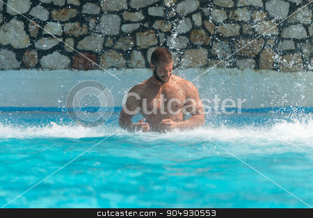 Muscular Man Standing Under A Water stock photo, Man In A Public Swimming Pool Standing Under A Water by Jasminko Ibrakovic