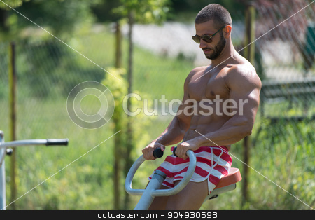 Muscular Man Training On The Playground In Park stock photo, Handsome Muscular Young Man - Training On The Playground In Park by Jasminko Ibrakovic