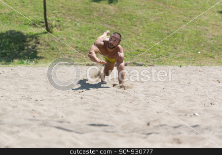 Male Beach Volleyball Game Player Jump On Sand stock photo, Muscular Young Man Playing Beach Volleyball Diving After The Ball by Jasminko Ibrakovic
