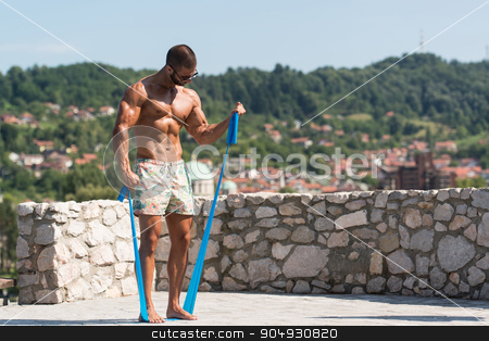 Biceps Exercise Using Resistance Bands stock photo, Handsome Guy Working Out With Rubber Outdoors by Jasminko Ibrakovic