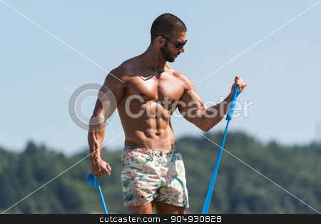 Biceps Exercise Using Resistance Bands stock photo, Sportsman Exercising With A Resistance Band Outdoors by Jasminko Ibrakovic
