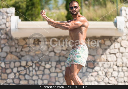 Man Showing His Well Trained Body Outdoors stock photo, Portrait Of A Physically Fit Man Showing His Well Trained Body Outdoors In Summer Time by Jasminko Ibrakovic