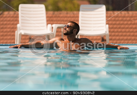 Man Resting Relaxed On Edge Of Swimming Pool stock photo, Fashion Portrait Of A Very Muscular Sexy Man In Underwear At Swimming Pool by Jasminko Ibrakovic