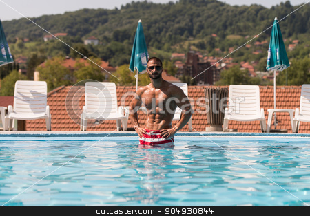 Relaxing In The Swimming Pool stock photo, Fashion Portrait Of A Very Muscular Sexy Man In Underwear At Swimming Pool by Jasminko Ibrakovic