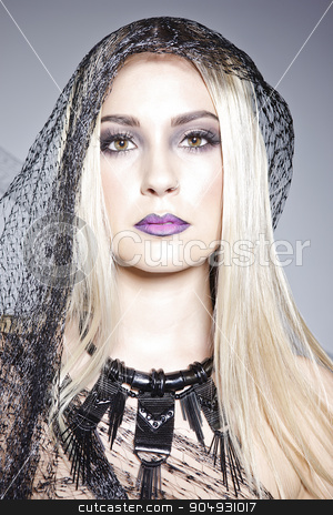 A portrait of a model with black veil stock photo, A portrait shot of a blonde model with fashionable makeup and a black veil around her head by JRstock