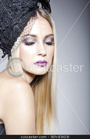 Gorgeous model wearing a hat with veil stock photo, Gorgeous model  with a fashionable makeup wearing a hat decorated with veil and a strapless top by JRstock