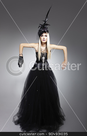 Model wearing a bohemian dress stock photo, Beautiful blonde model wearing a bohemian dress, a hat with veil and feathers and a satin glove that finishes the look by JRstock