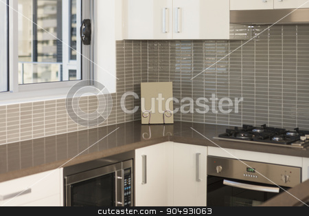 Detail of a modern kitchen stock photo, Detail of a modern kitchen with an oven and a microwave by JRstock
