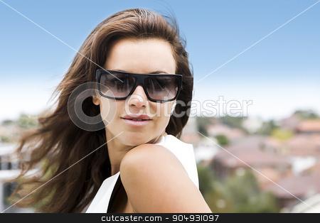 Closeup portrait of a brunette stock photo, Closeup portrait of a brunette wearing sunglasses by JRstock