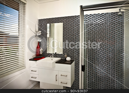 A beautiful modern stylish bathroom  stock photo, A beautiful modern stylish bathroom witha  window and shower on right side by JRstock