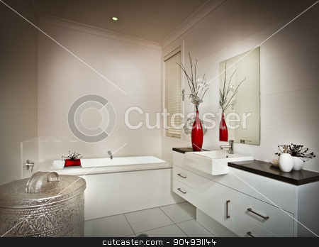 Picture of a beautiful white washroom stock photo, Picture of a beautiful white washroom with a tub bath and a mirror by JRstock